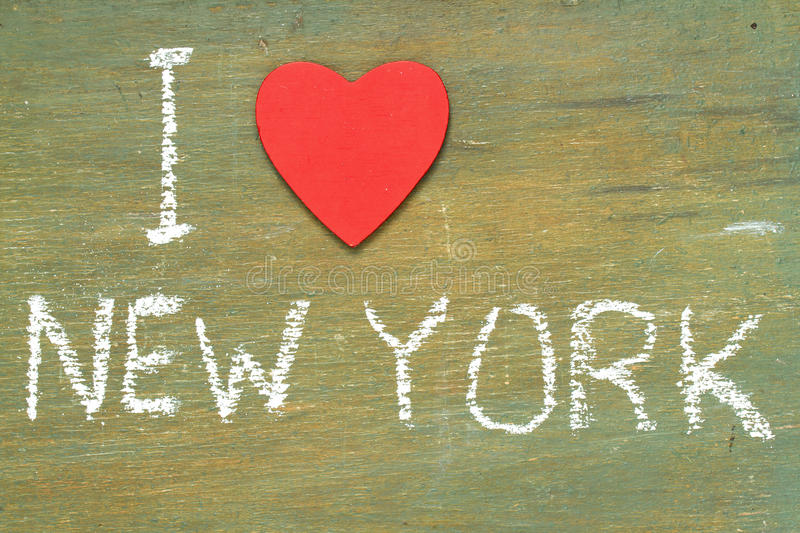 Text i love new york. Written with chalk in old board wooden royalty free stock images
