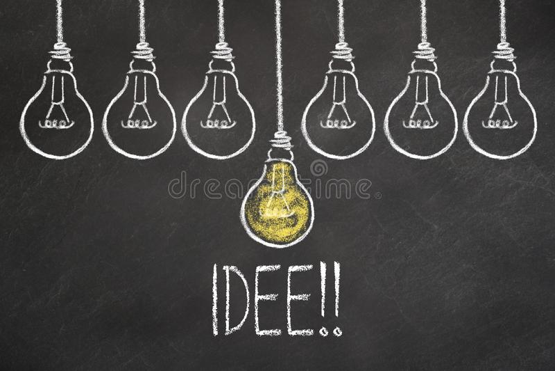 Text `Idee` and light bulbs on chalkboard. Translation: `Idea` vector illustration