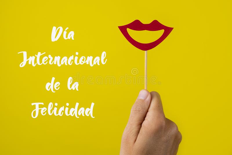 Text international happiness day in spanish royalty free stock photography