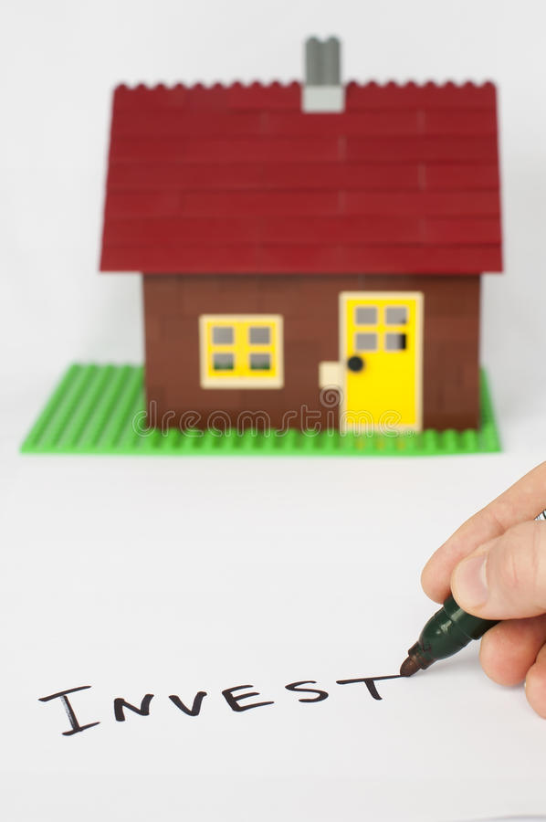 Text Invest and house on background. royalty free stock photos