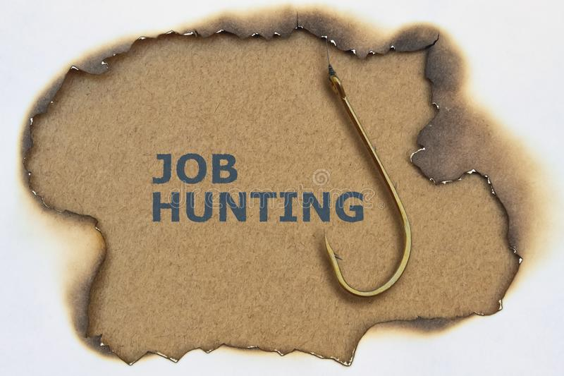 Text Job Hunting. And fishing hook on brown background stock photos