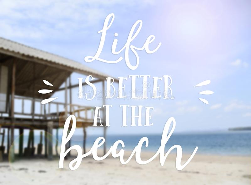 Text life is better at the beach summer quotes with beautiful beach background royalty free stock image