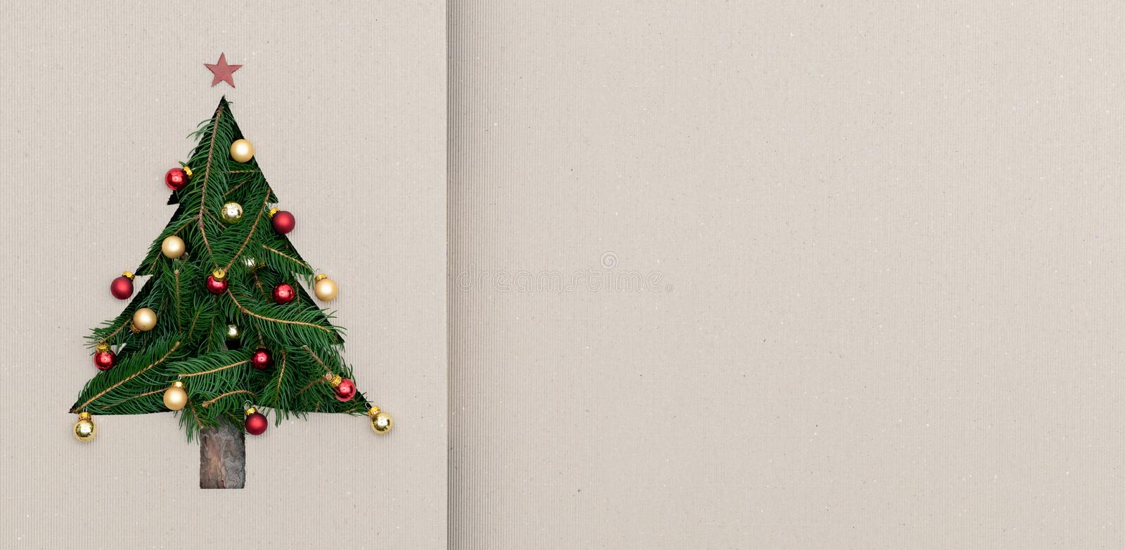 Text or logo empty copy space in vertical top view cardboard with natural eco decorated christmas tree pine.Xmas winter stock image