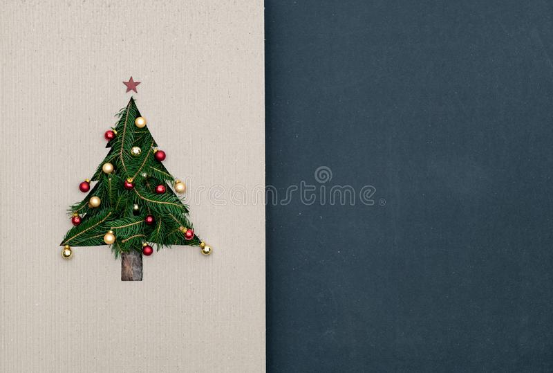 Text or logo empty copy space in vertical top view dark blackboard with natural eco decorated christmas tree pine in stock photography