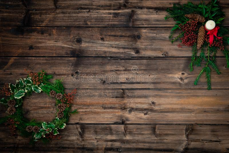 Text or logo empty copy space,vertical top view dark vintage wood.Pine tree branches, wreath garland.Natural eco concept stock photos