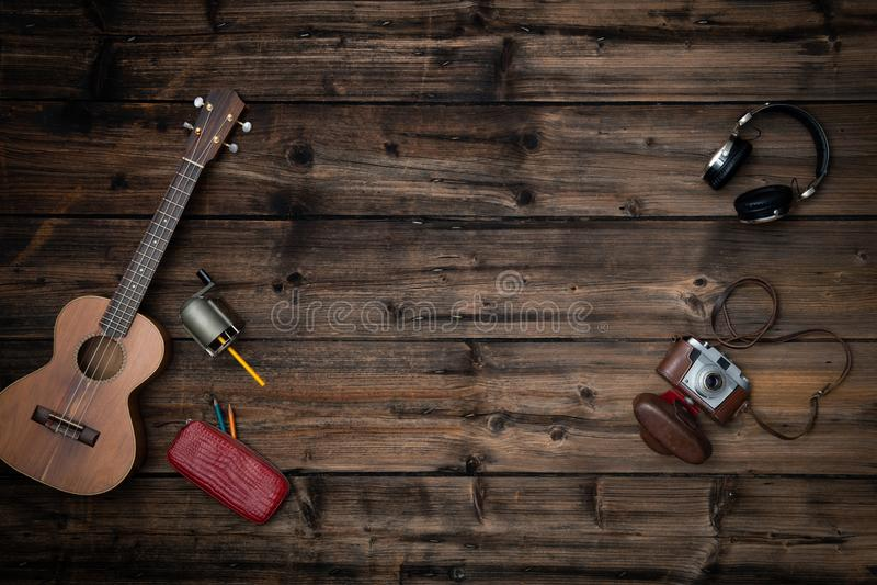 Text or logo empty copy space in vertical top view dark vintage wood.Retro sharpener,guitar ukulele,camera,headphones stock images