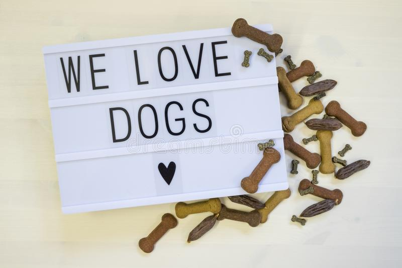 Text We love Dogs written on a lightbox stock image
