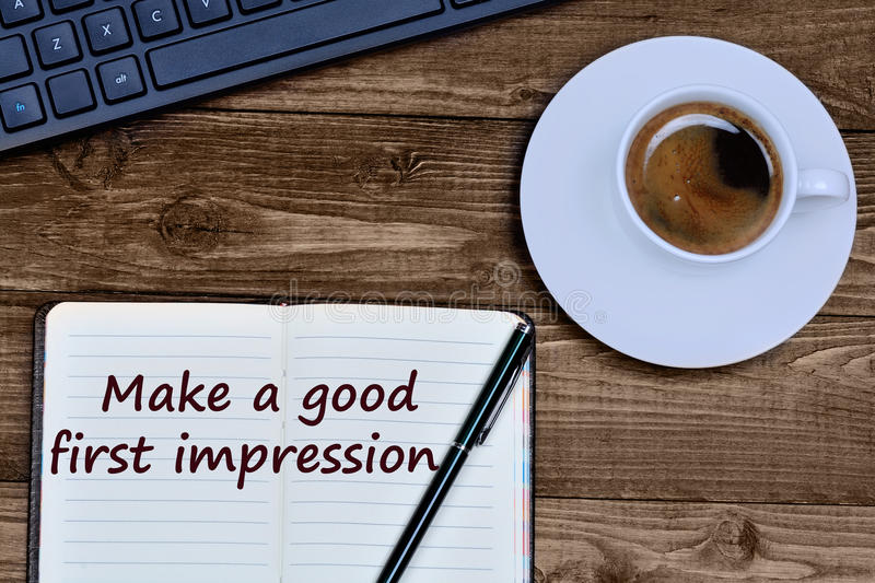Text Make a good first impression on notebook. Page stock images