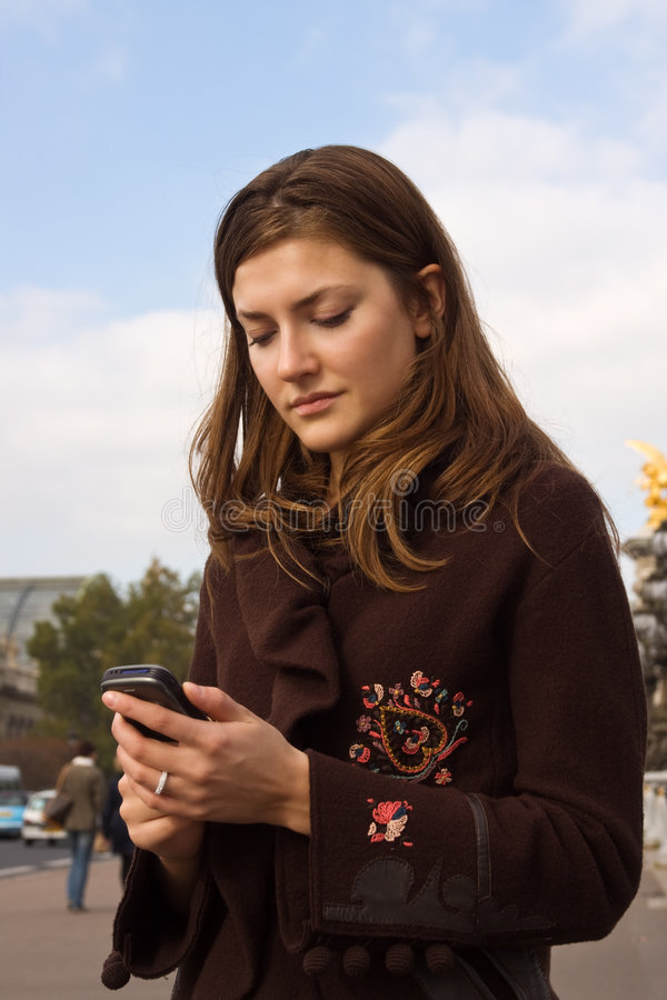 Download Text me! stock photo. Image of buzz, coat, speak, typing - 5199960