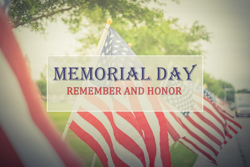 Text Memorial Day and Honor on row of lawn American Flags. Text Memorial Day and Honor on long row of lawn American Flags background. Green grass yard USA flags royalty free stock images
