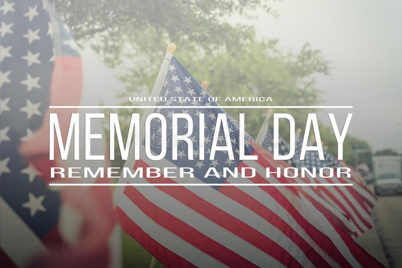 Text Memorial Day remember and honor on row of lawn American Fla. Text Memorial Day remember and honor on long row of lawn American Flags background. Green grass royalty free stock photo