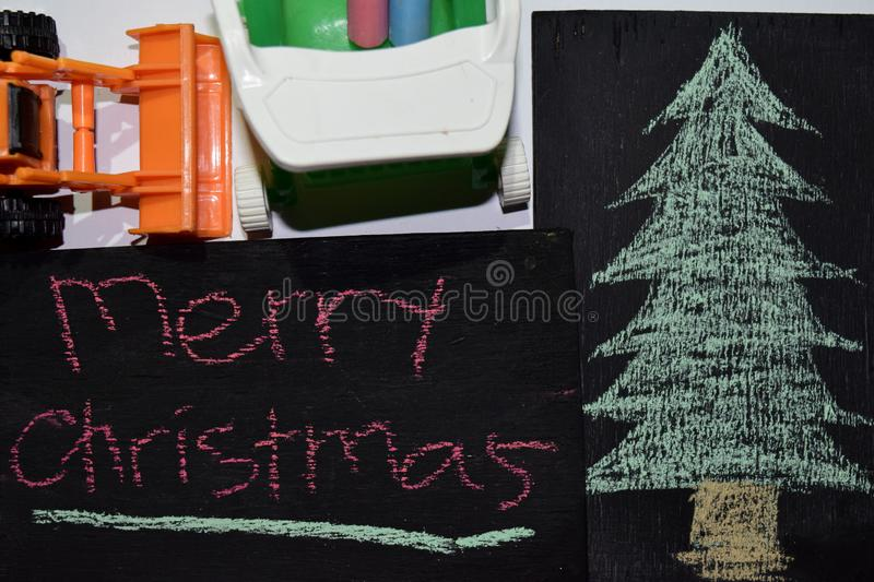 Text Merry Christmas - New Year holiday background - black chalkboard stock photos