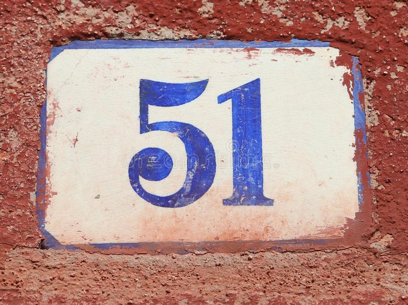 Text with number 51 on the wall stock images