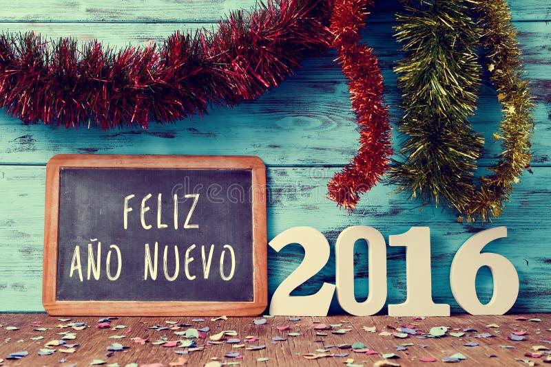 Text o nuevo 2016 do ano do feliz, ano novo feliz 2016 no espanhol fotos de stock