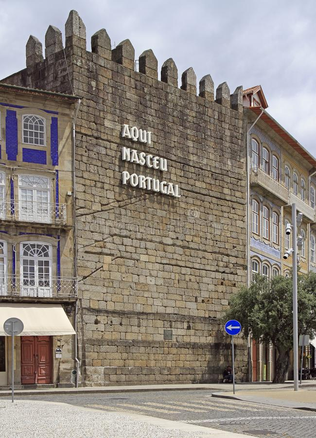 Text `Portugal was born here` on the wall in Guimaraes royalty free stock image