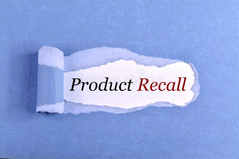 The text Product Recall. Appearing behind ripped blue paper stock images