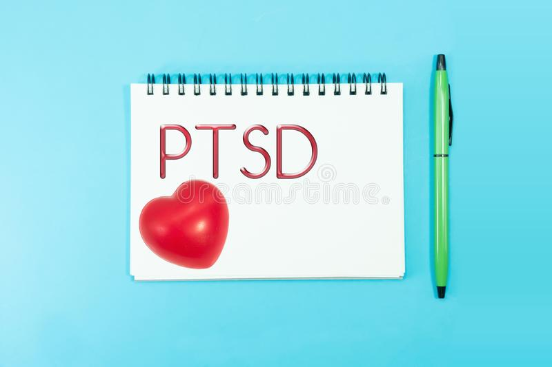 Text PTSD of Posttraumatic stress disorder on paper with rubber royalty free stock photos