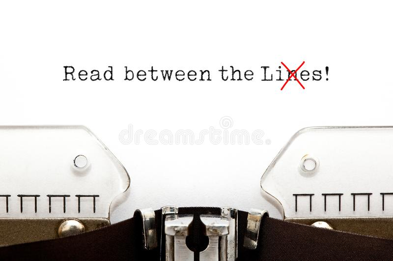 Read Between The Lies Concept On Typewriter stock images