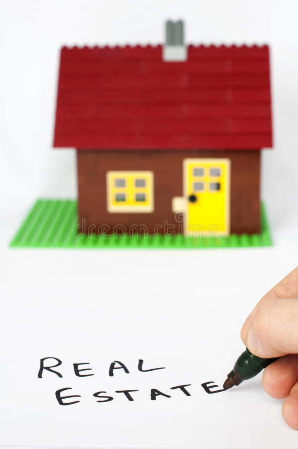 Text real estate and house on background royalty free stock images