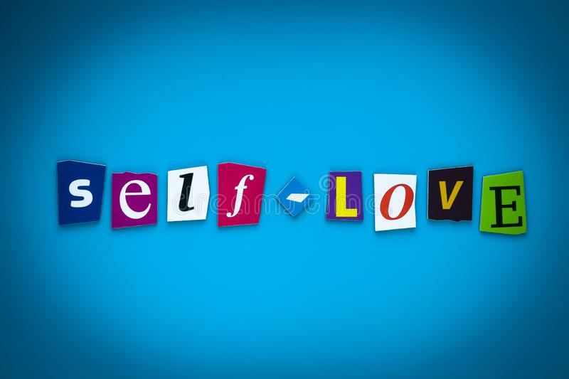Text Self-Love on blue background from colorful letters. Multicolored inscription on card, banner. Headline, caption, heading. Psy royalty free illustration