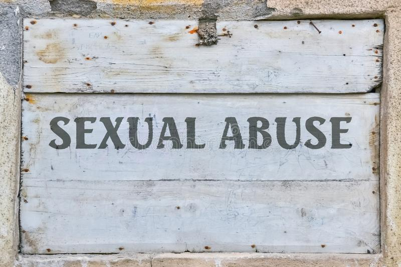 Text Sexual Abuse. Written on vintage wooden background stock images