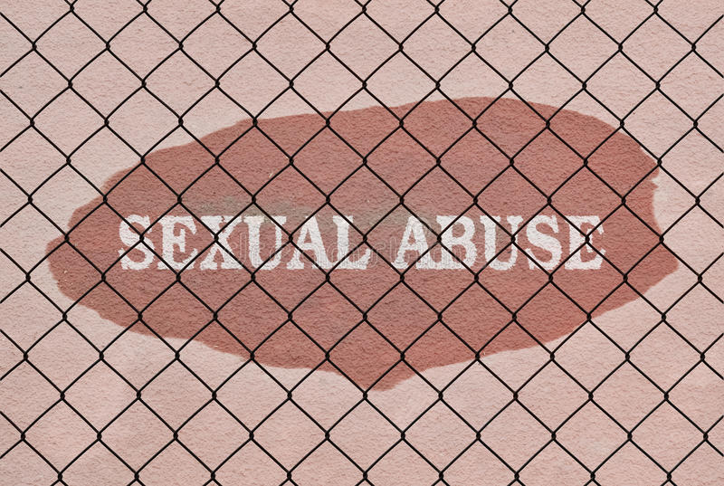 Text Sexual Abuse. Written under a wire fence royalty free stock images
