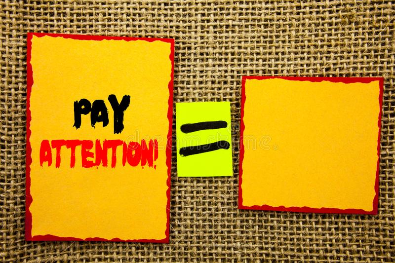 Text showing Pay Attention. Business photo showcasing Be Careful Beware Mindful Alarm written on Sticky note Paper Equation For Yo. Text showing Pay Attention royalty free stock photography