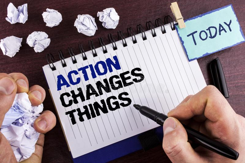 Text sign showing Action Changes Things. Conceptual photo doing something is like chain Improve Reflects written by Man on Notepad. Text sign showing Action royalty free stock photo