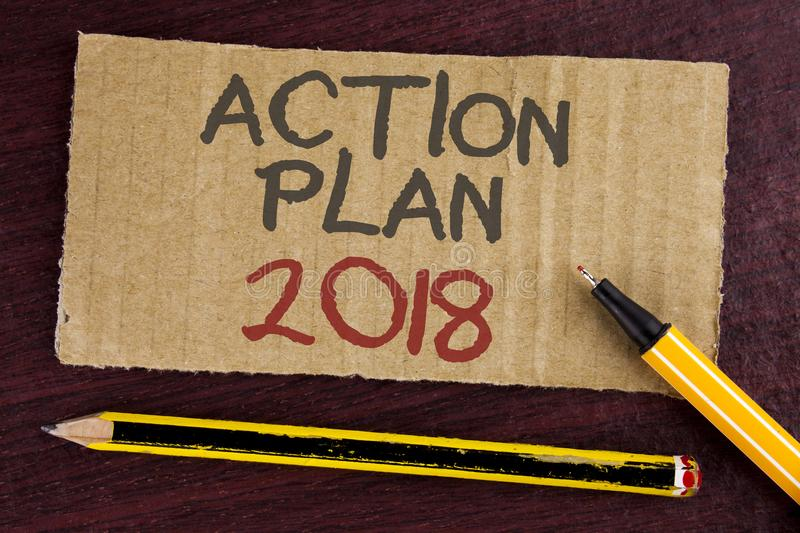 Text sign showing Action Plan 2018. Conceptual photo to do list in new year New year resolution goals Targets written on Cardboard. Text sign showing Action Plan stock photography