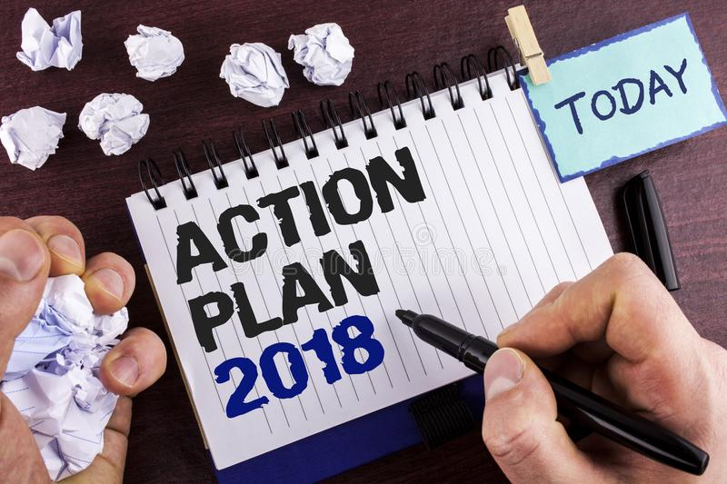 Text sign showing Action Plan 2018. Conceptual photo to do list in new year New year resolution goals Targets written by Man on No. Text sign showing Action Plan royalty free stock photography