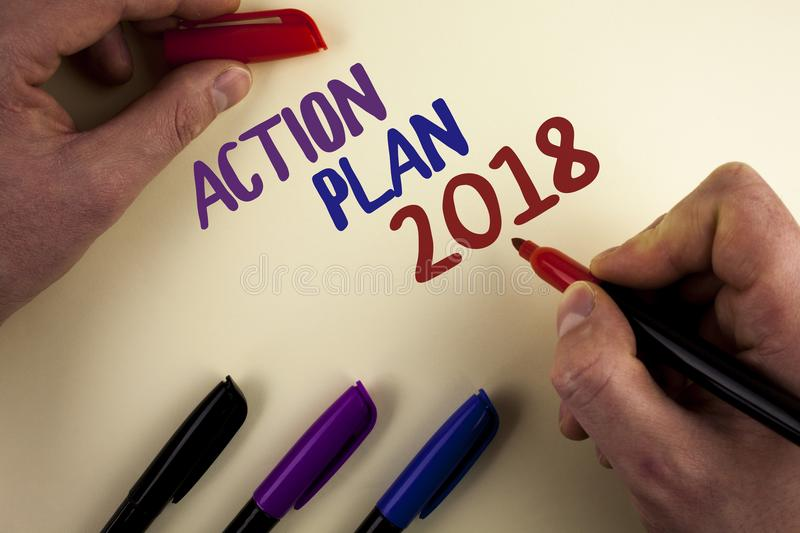 Text sign showing Action Plan 2018. Conceptual photo to do list in new year New year resolution goals Targets written by Man on pl. Text sign showing Action Plan royalty free stock photos