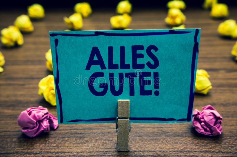 Text sign showing Alles Gute. Conceptual photo german translation all the best for birthday or any occasion Clothespin holding blu stock images