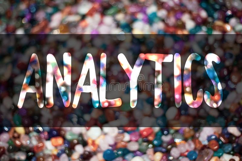 Text sign showing Analytics. Conceptual photo Data Analysis Financial Information Statistics Report Dashboard Blurry candies candy. Ideas message reflection stock image