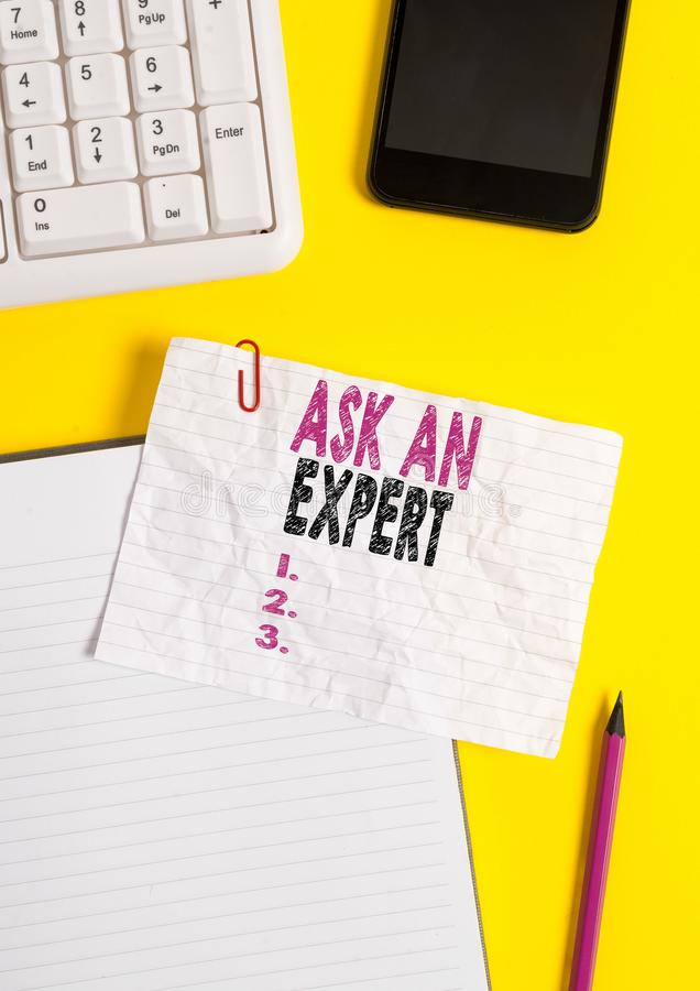 Text sign showing Ask An Expert. Conceptual photo consult someone who has skill about something or knowledgeable. Text sign showing Ask An Expert. Business photo royalty free stock photo