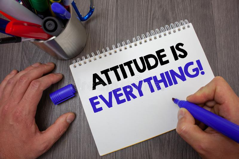 Text sign showing Attitude Is Everything. Conceptual photo Personal Outlook Perspective Orientation Behavior Man hold holding blue. Marker notebook page markers stock photography
