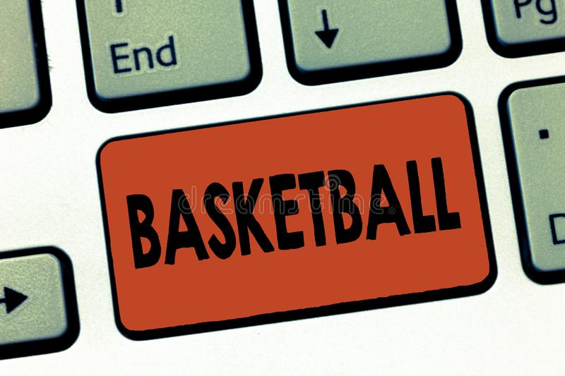 Text sign showing Basketball. Conceptual photo Sport Indoors court game Competition throw ball to open net.  stock photos