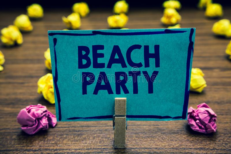Text sign showing Beach Party. Conceptual photo small or big festival held on sea shores usually wearing bikini Clothespin holding. Blue paper note crumpled stock photography