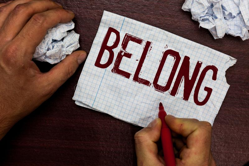 Text sign showing Belong. Conceptual photo property of someone be member of particular group or organization Man holding. Marker notebook page crumpled papers royalty free stock images