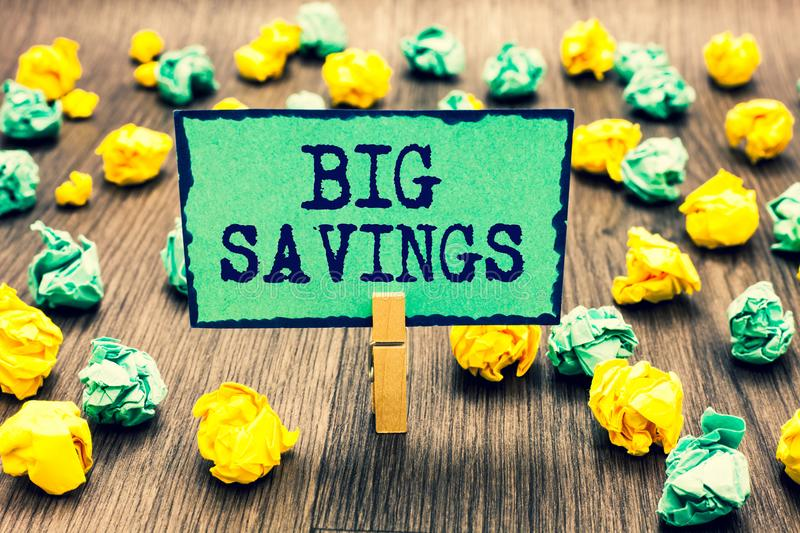 Text sign showing Big Savings. Conceptual photo income not spent or deferred consumption putting money aside Clothespin holding gr. Een note paper crumpled stock images