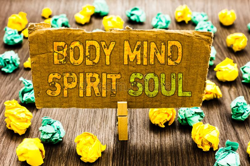 Text sign showing Body Mind Spirit Soul. Conceptual photo Personal Balance Therapy Conciousness state of mind Paperclip grip cardb royalty free stock photos