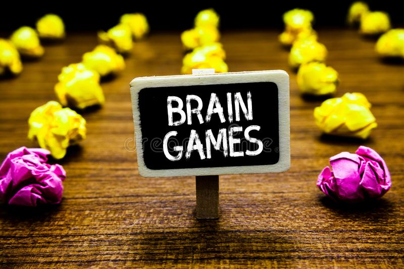 Text sign showing Brain Games. Conceptual photo psychological tactic to manipulate or intimidate with opponent Blackboard crumpled. Papers several tries mistake stock photo