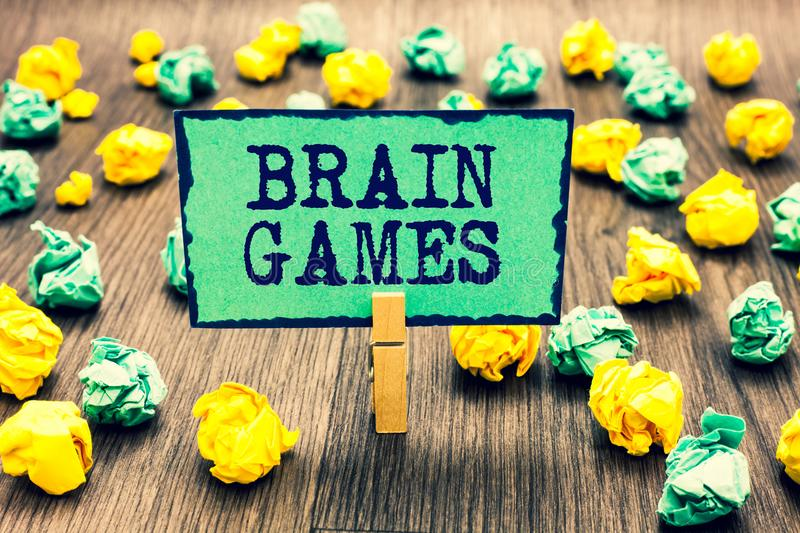 Text sign showing Brain Games. Conceptual photo psychological tactic to manipulate or intimidate with opponent Clothespin holding. Green note paper crumpled stock photo