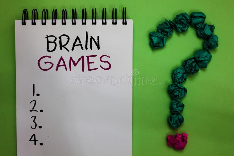 Text sign showing Brain Games. Conceptual photo psychological tactic to manipulate or intimidate with opponent Open notebook crump. Led papers forming question stock photos