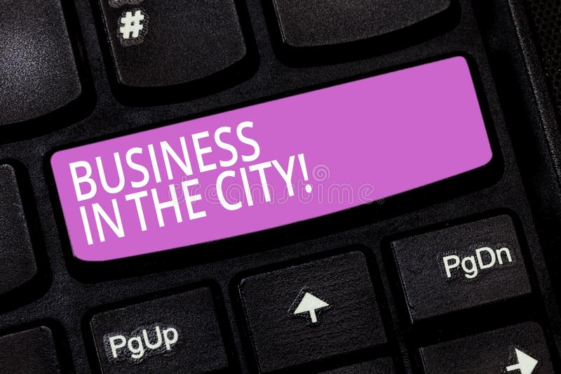 Text sign showing Business In The City. Conceptual photo Urban companies Professional offices in cities Keyboard key. Intention to create computer message stock image