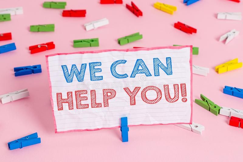 Text sign showing We Can Help You. Conceptual photo offering good assistance to customers or friends Colored clothespin. Text sign showing We Can Help You royalty free stock images
