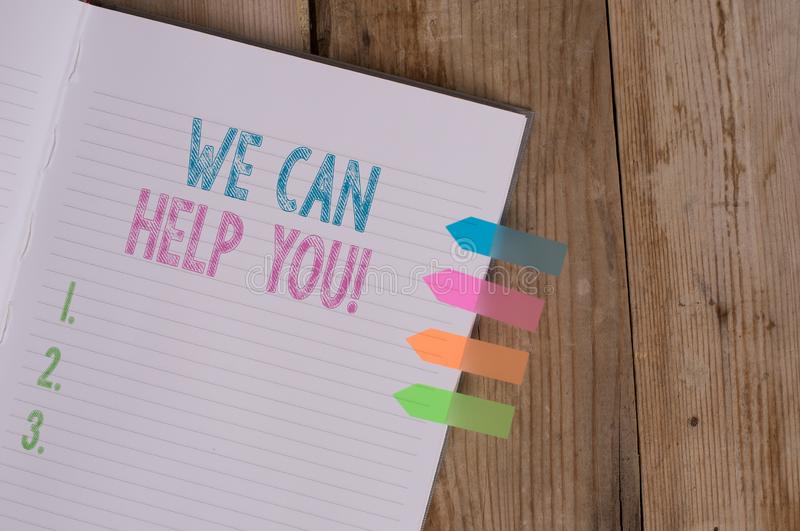 Text sign showing We Can Help You. Conceptual photo offering good assistance to customers or friends Striped note book. Text sign showing We Can Help You stock photos