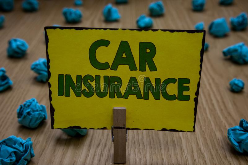 Text sign showing Car Insurance. Conceptual photo Accidents coverage Comprehensive Policy Motor Vehicle Guaranty Clothespin holdin. G yellow paper note crumpled stock photography