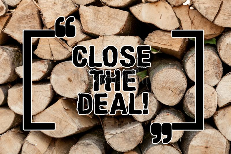 Text sign showing Close The Deal. Conceptual photo Agreement for business Successful working on a team Wooden background. Vintage wood wild message ideas stock image