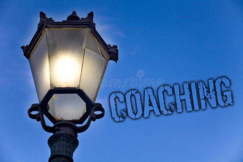 Text sign showing Coaching. Conceptual photo Prepare Enlightened Cultivate Sharpening Encourage Strenghten Light post blue sky enl. Ighten ideas message old stock image