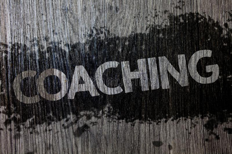 Text sign showing Coaching. Conceptual photo Prepare Enlightened Cultivate Sharpening Encourage Strenghten Wooden wood background. Black splatter paint ideas royalty free stock photo